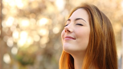 A woman practicing mindfulness techiniques to deal with her ADHD symptoms.