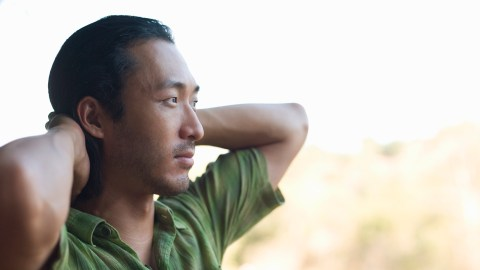 A man looks toward the horizon and contemplates what it feels like to have ADHD