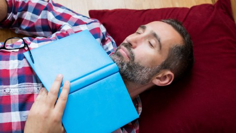 ADHD man takes a nap on the couch, which explains why he can't sleep later that night.
