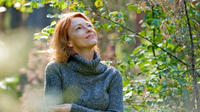 A woman with ADHD walks in the woods and enjoys the scenery