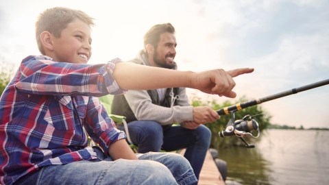 A father and son fish together, a good way to bond and establish relationships for effective child discipline.