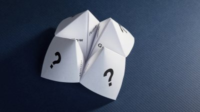 Paper fortune teller signifying the difficulty of decision making for ADHD adults