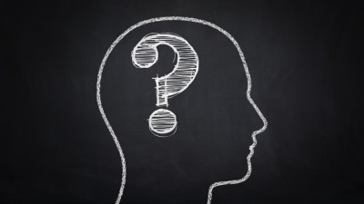 Illustration of profile of ADHD person's head with question mark in it