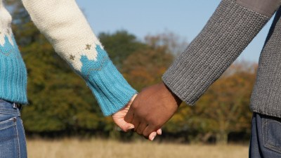 A supportive couple holding hands after an ADHD diagnosis