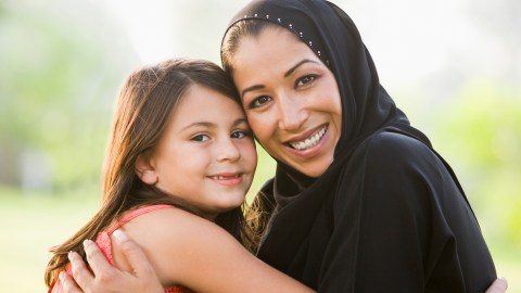 A mother and daughter smiling as the result of positive parenting