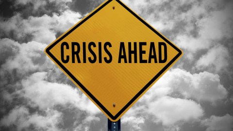 A road sign that says crisis ahead. People experiencing ADHD stress feel this way all the time.
