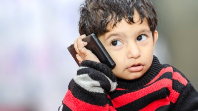 A child with a language processing disorder talking on the phone
