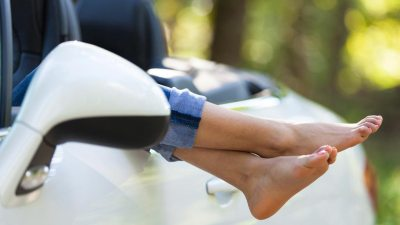 Feet of ADHD teen hanging out of car window