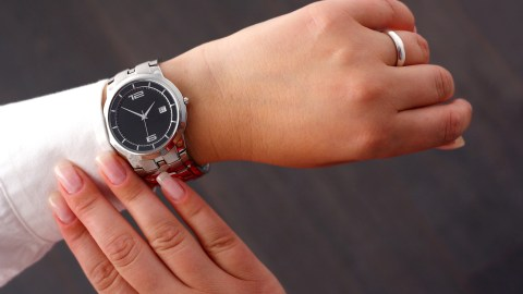 A woman looks at her watch — something a good therapist would not do during a session.