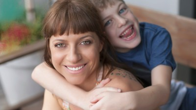 Strong ADHD family of Mom with son laughing