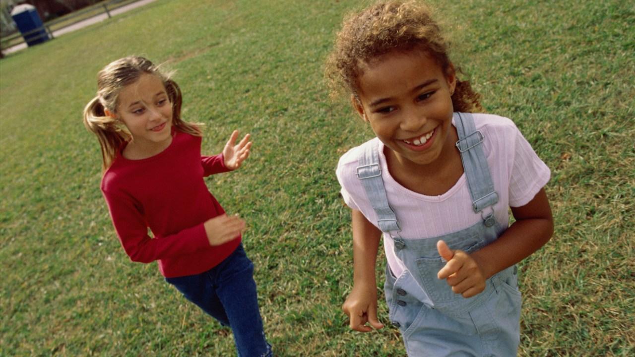Girls running around outside