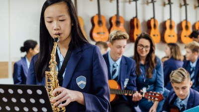 A teenager with ADHD, playing saxophone in a performing arts class