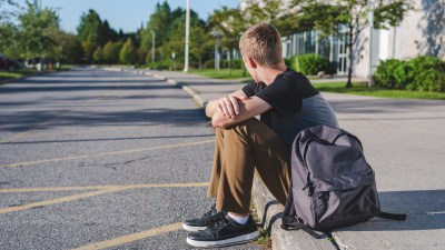 Teen waiting by school