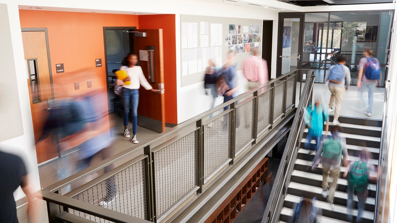 Students with ADHD walk the hallways of college.