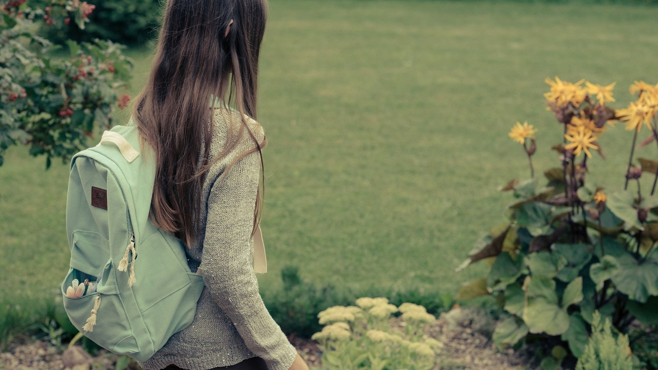 A teen with ADHD walks outside and ponders her options after high school.