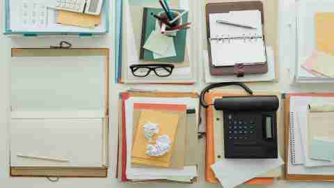 A desk full of paper clutter