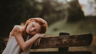 Child tired on bench