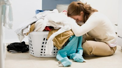 a woman with ADHD who is successful at work finds laundry and other household tasks stressful