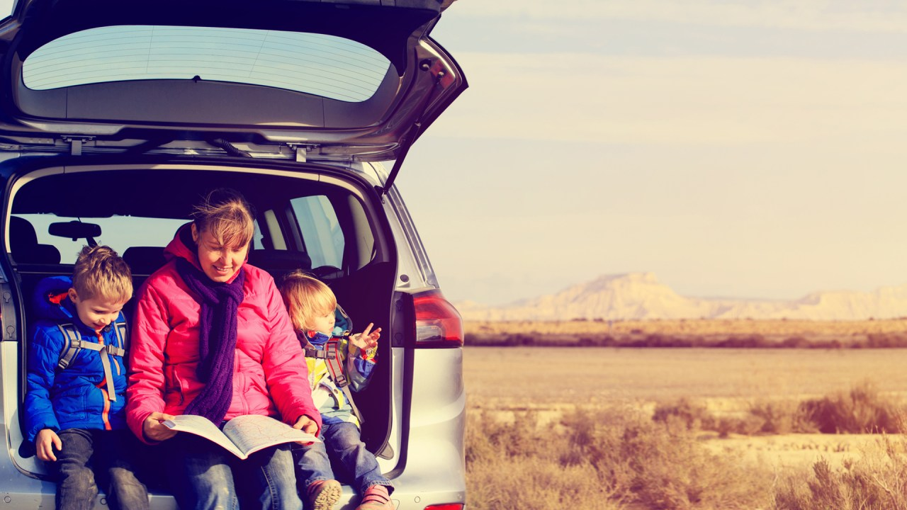 mother and children take a rest stop during a calm, peaceful car ride thanks to effective ADHD treatment