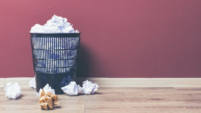 wastebasket filled with crumpled paper by ADHD adult who struggles with perfectionism