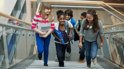 group of middle school girls with ADHD walking up stairs, talking