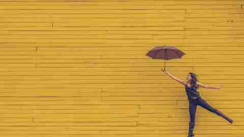 Happy woman with ADHD holds an umbrella