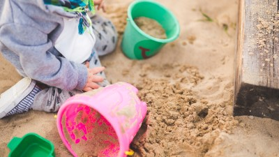 Child with EFD playing in sandbox