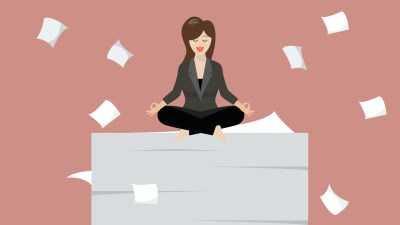 a young woman with ADHD sits on a stack of paper, productive and calm at her first job