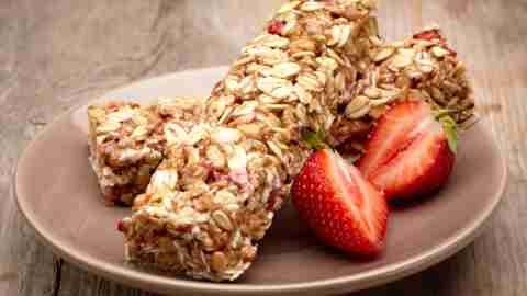 A granola bar and strawberries, breakfast should be part of a good morning routine