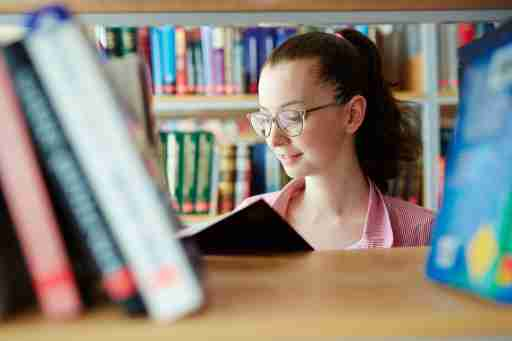 A girl reads books for kids with ADHD in the library