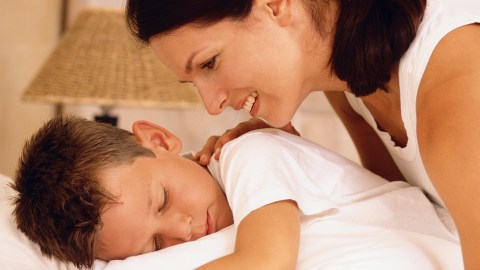 A mother wakes up her child with ADHD.