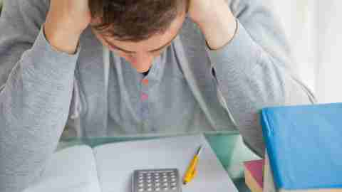 Dsycalculia in adults: A college student with ADHD and symptoms of dyscalculia is frustrated while working on a math assignment.