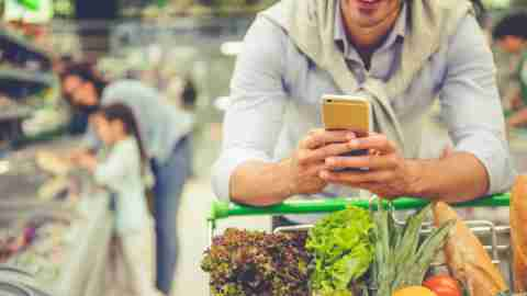 Dad with ADHD in supermarket on phone