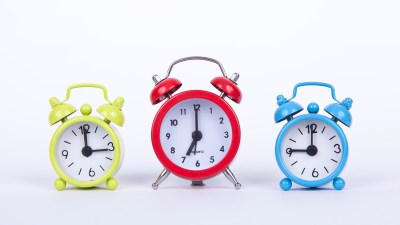 A group of alarm clocks set to remind you of important times, a valuable tool to manage ADHD in the workplace.