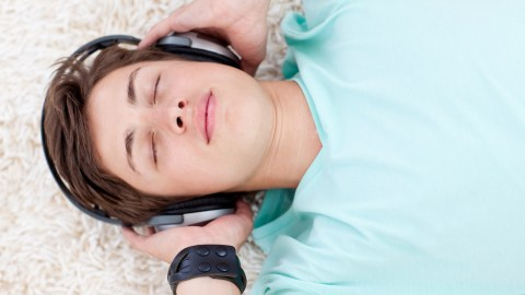 Boy listening to headphones getting music therapy for children with ADHD.