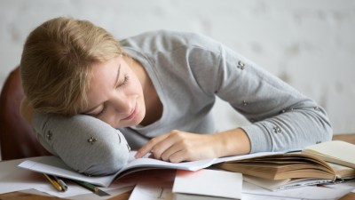 Portrait of a student girl with ADHD sleeping at the desk