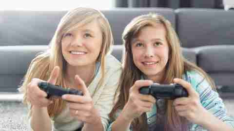 Two teens with ADHD play video games together