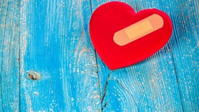 A red heart with a Band-Aid representing the hurtful words our kids hear about ADHD.