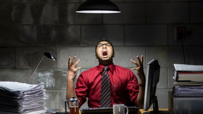 A man explodes in anger, showing symptoms of oppositional defiant disorder in adults.