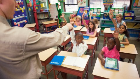 A teacher calls on a student with ADHD who has his hand raised