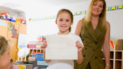 A student with ADHD shows off her A+ grade