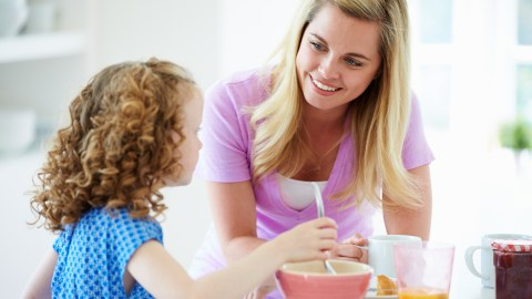 A mother helps her daughter through her customized daily routine for children with ADHD.