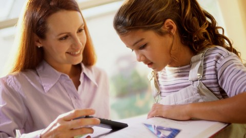 A mother and daughter working on a take home assignment together as part of a customized 504 plan.