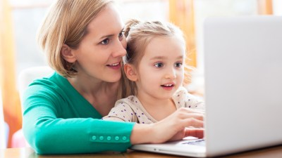 A mother and daughter setting specific 504 plan goals on a computer together.