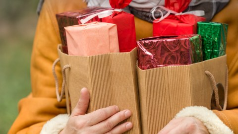Person holding holidays gifts and wondering about stress relief