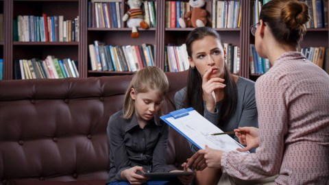 Mom with ADHD daughter talking about anger management with therapist
