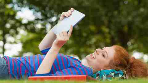 Girl student with ADHD studying outside in nature