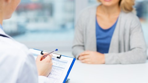 A doctor conducts an interview and explains ADHD medication and treatment options.