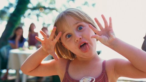 Girl makes a funny face as people talk about how she'll outgrow ADHD.