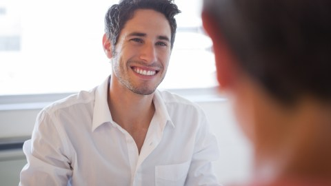A man is smiling, but jokes about having an ADHD kind of day aren't funny.